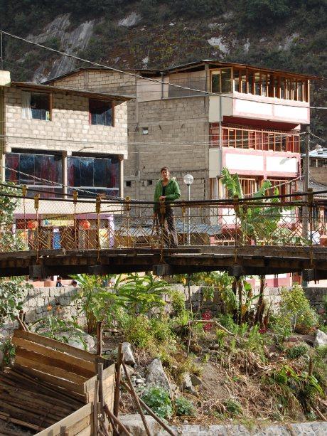 Jen on a bridge at Aguas Calientes at the base of Machu Picchu