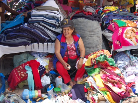 "When I took her picture she said, ""Ayyy Gringo!"" (Her hat reads ""Miami Vice Police"")  Pic from Nasca markets"